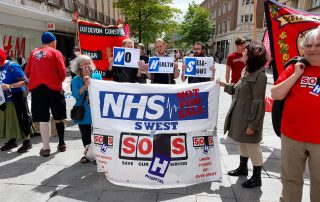 SOHS and KONP protesters with a banner which says NHS not for Sale South West