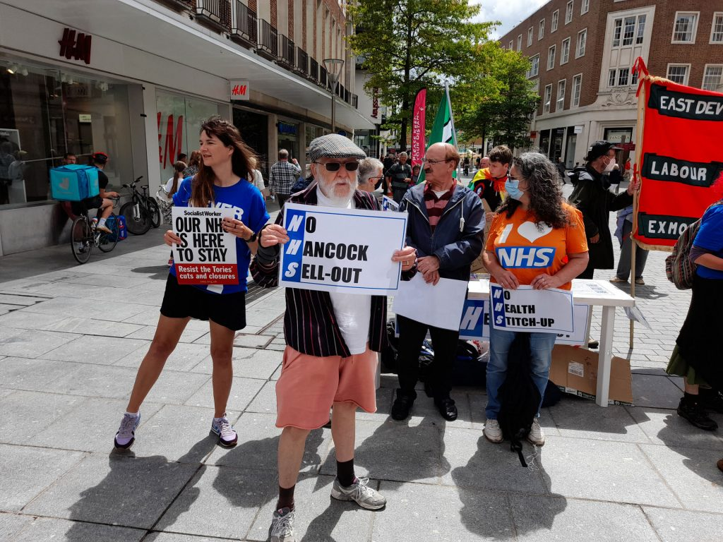 Protesters with placards reading 'No Health Stitch-up', 'No Hancock Sell-Out' and 'Our NHS is Here to Stay'